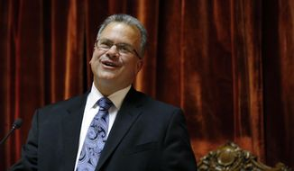 Democrat Nicholas Mattiello, of Cranston, R.I., speaks after being sworn in as the new House Speaker by the Rhode Island House of Representatives at the Statehouse in Providence, Tuesday, March 25, 2014. Mattiello was elected after the abrupt resignation of Gordon Fox, one of the most powerful figures in state government, after his home and Statehouse office were raided as part of a criminal probe. (AP Photo/Elise Amendola)