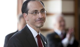 Scott Flanagan is named seventh president of Edgewood College, Tuesday, March 25, 2014. Flanagan currently is executive vice president at Edgewood and has had other roles during his 16 years with the college. (AP Photo/Wisconsin State Journal, Steve Apps)