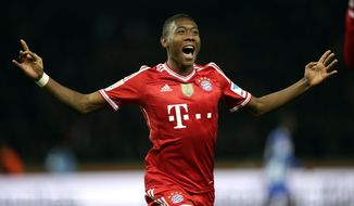 Bayern's David Alaba of Austria celebrates his team's opening goal scored by Toni Kroos during  the German Bundesliga soccer match between Hertha BSC Berlin and Bayern Munich in Berlin, Germany, Tuesday, March 25, 2014. (AP Photo/Michael Sohn)