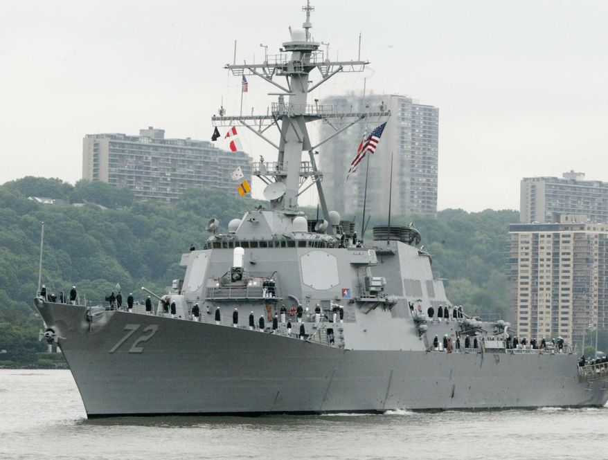 FILE - In this May 26, 2004 file photo, the USS Mahan, a guided-missile destroyer, moves up the Hudson River in New York during Fleet Week. A sailor was fatally shot aboard the USS Mahan at Naval Station Norfolk late Monday, March 24, 2014, and security forces killed a male civilian suspect, base spokeswoman Terri Davis said. (AP Photo/Ed Bailey, File)