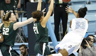 North Carolina's Diamond DeShields (23) goes to the basket against Michigan State's Becca Mills, left, and Klarissa Bell during the first half of a second-round game of the NCAA college basketball tournament in Chapel Hill, N.C. Tuesday, March 25, 2014. (AP Photo/Ellen Ozier)