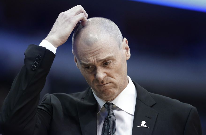 Dallas Mavericks coach Rick Carlisle walks the sideline during the first half of an NBA basketball game against the Dallas Mavericks on Tuesday, March 25, 2014, in Dallas. (AP Photo/LM Otero)