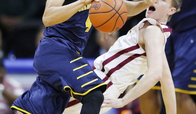 Emmanuel guard Luke Miller, back, is called for a blocking foul on Vanguard guard Preston Wynne (4) during the first half of an NAIA college basketball game and finals of the men's national championship tournament in Kansas City, Mo., Tuesday, March 25, 2014. (AP Photo/Orlin Wagner)