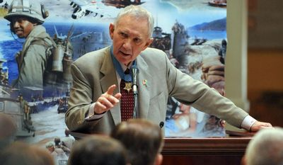 Medal of Honor recipient Major General James Livingston, USMC (Ret.), speaks during aceremony honoring Georgia's Medal of Honor recipients at the Georgia Capitol Tuesday, March 25, 2014, in Atlanta.  (AP Photo/Atlanta Journal-Constitution, Kent D. Johnson)  MARIETTA DAILY OUT; GWINNETT DAILY POST OUT; LOCAL TV OUT; WXIA-TV OUT; WGCL-TV OUT