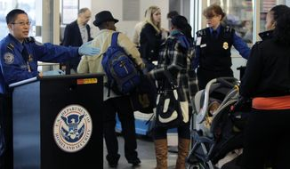 FILE - In this Nov. 23, 2010 file photo, travelers make their way through a security checkpoint at LaGuardia Airport in New York. In 2013, 25 gun-packing out-of-towners were arrested on felony weapons charges for traveling armed at New York's busy LaGuardia and Kennedy airports. Such strict enforcement of New York's tough gun laws is intended to send a message not to bring firearms to New York in the first place, and that message may be getting through. (AP Photo/Seth Wenig, File)