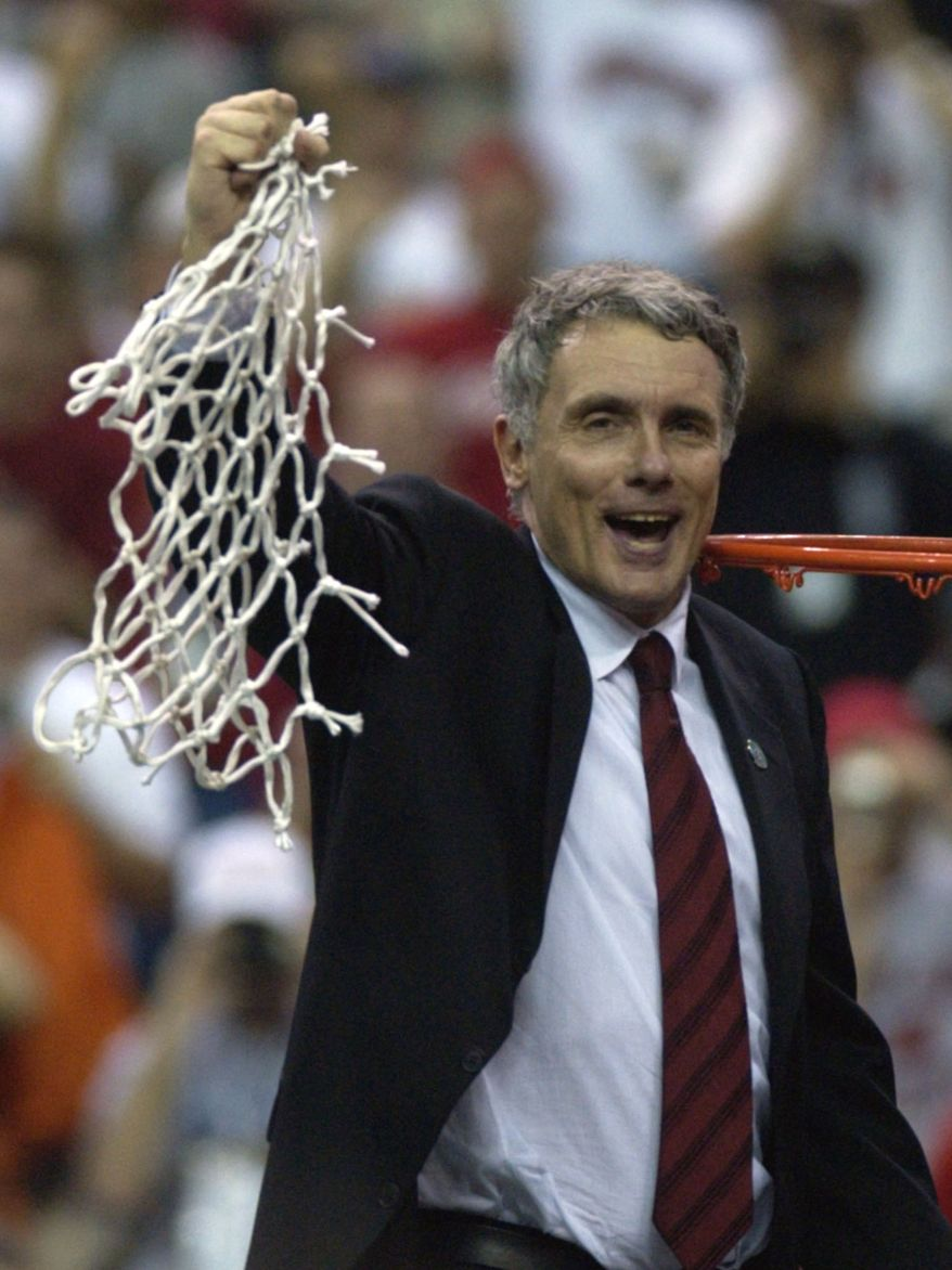 Maryland coach Gary Williams swings the net after his Terps beat Indiana 64-52 in the NCAA final in Atlanta Monday, April 1, 2002. (AP Photo/John Bazemore)