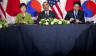 President Barack Obama, Japanese Prime Minister Shinzo Abe, right, and South Korean President Park Geun-hye, participate in a trilateral meeting at the US Ambassador's Residence in the Hague, Netherlands, Tuesday, March 25, 2014. (AP Photo/Pablo Martinez Monsivais)