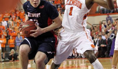 Belmont's Craig Bradshaw, left, drives to the basket as Clemson's Austin Ajukwa defends during the first half of their NCAA college basketball National Invitational Tournament game at Littlejohn Coliseum in Clemson, S.C., on Tuesday, Mar. 25, 2014. (AP Photo/Anderson Independent-Mail, Mark Crammer)
