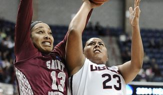 Saint Joseph's Ashley Robinson, left, fouls Connecticut's Kaleena Mosqueda-Lewis, right, as she makes a basket during the first half of a second-round game of the NCAA women's college basketball tournament, Tuesday, March 25, 2014, in Storrs, Conn. (AP Photo/Jessica Hill)