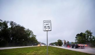 A speed limit sign is seen on the center median of U.S. 301 within the Hampton City limits on Tuesday, March 18, 2014 in Hampton, Florida.  The small 477 person city in Bradford County, known as a notorious speed trap, recently came under heavy scrutiny when results of a state audit revealed numerous problems including a lack of oversight, duplicate paychecks, missing deposits, lost records, lost revenue and other glaring irregularities. (AP Photo/The Tampa Bay Times, Kent Nishimura)