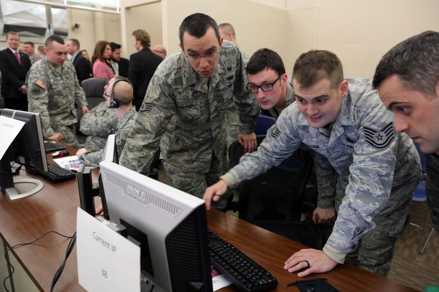 The Michigan Air National Guard Cyber Team at the 110th Airlift Wing W.K. Kellogg Air National Guard Base in Battle Creek, Mich, watch computer monitor during a training session Tuesday, march 25, 2014, against the U.S. Academy at West Point New York and California Air National Guard. Their objective is to be the first to take over servers. (AP Photo/Kalamazoo Gazette-MLive Media Group, Mark Bugnaski) ALL LOCAL TV OUT; LOCAL TV INTERNET OUT