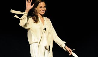 """Angelina Jolie, director of the upcoming film """"Unbroken,"""" makes a surprise appearance onstage to introduce a trailer for the film during a Universal Pictures studio presentation at CinemaCon 2014 on Tuesday, March 25, 2014 in Las Vegas. (Photo by Chris Pizzello/Invision/AP)"""