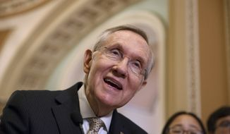 Senate Majority Leader Harry Reid of Nev. speaks to reporters on Capitol Hill in Washington, Tuesday, March 25, 2014, after a Democratic caucus luncheon. Reid said Democrats are likely to remove a major roadblock preventing Congress from passing legislation authorizing sanctions on Russia and providing aid to Ukraine. He added that it appears that Democrats have agreed on a way to move the legislation forward without a provision affecting the International Monetary Fund. He says he feels strongly about IMF reforms, but that it's important to assist Ukraine and hit Russia with sanctions over its military incursion into Crimea. (AP Photo/J. Scott Applewhite)