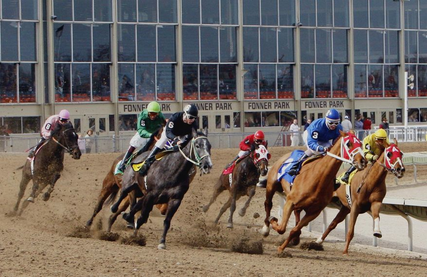 FILE - In this file photo from March 14, 2008, horses round the track at Fonner Park in Grand Island, Neb. A proposed constitutional amendment to allow betting on old horse races in Nebraska is scheduled for a final vote on Tuesday, march 25, 2014, but opponents in the Legislature will mount a last-ditch effort to try to block it. (AP Photo/Nati Harnik)