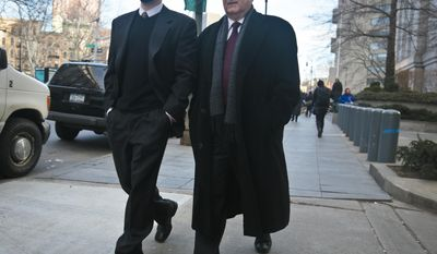 Daniel Bonventre, right, former director of operations for investments for imprisoned financier Bernard Madoff, leaves federal court on Monday, March 24, 2014, in New York. Bonventre is among five former employees of Madoff convicted of fraud that enriched them and cheated investors out of billions of dollars. (AP Photo/Bebeto Matthews)