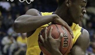 California's Jabari Bird rebounds against Arkansas in the second half of an NCAA college basketball game in the NIT tournament Monday, March 24, 2014, in Berkeley, Calif. (AP