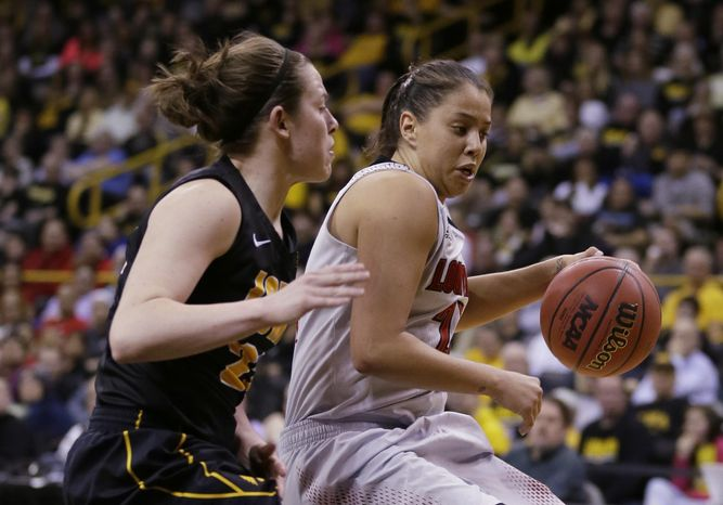 Louisville guard Shoni Schimmel, right, drives past Iowa guard Samantha Logic during the second half of an NCAA tournament second-round women's college basketball game, Tuesday, March 25, 2014, in Iowa City, Iowa. (AP Photo/Charlie Neibergall)