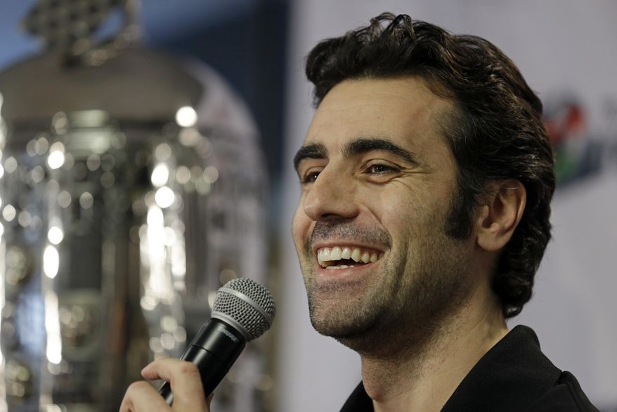 """FILE - In this Dec. 19, 2013 file photo, Dario Franchitti, of Scotland, answers a question during a press conference in Indianapolis. Three-time Indianapolis 500 winner Franchitti will drive the pace car in the 98th running of the Indy 500 in May. """"It is a tremendous honor for me to be asked to drive the pace car for the Indianapolis 500,"""" said Franchitti.  (AP Photo/Michael Conroy, File)"""