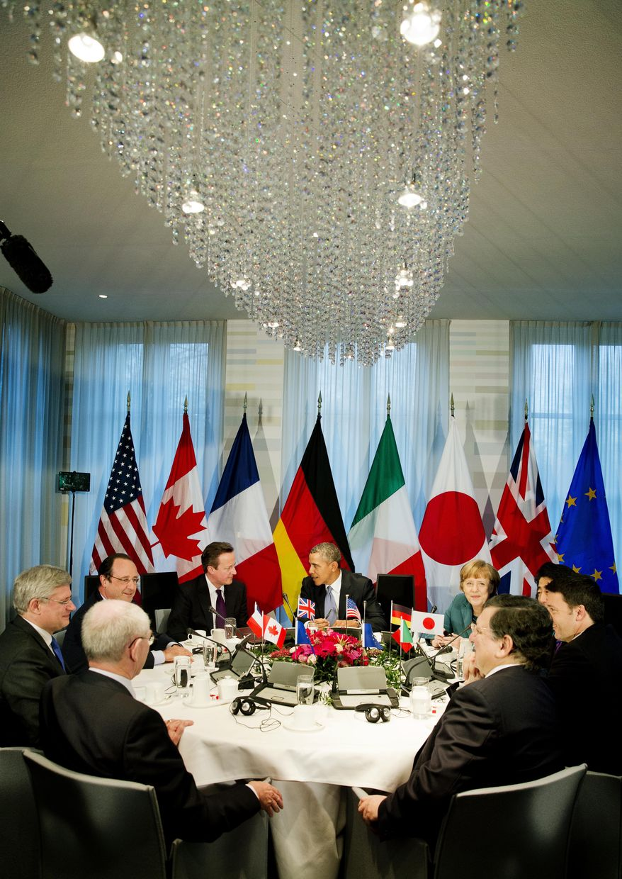 President Barack Obama, center rear,  gathered with G7 world leaders clockwise from center left, European Council president Herman Van Rompuy, Canadian Prime Minister Stephen Harper, French President Francois Hollande, British Prime Minister David Cameron, US President Barack Obama, German Chancellor Angela Merkel, Japanese Prime Minister Shinzo Abe, Italian Prime Minister Matteo Renzi and European Commission president Jose Manuel Barroso, in The Hague, Netherlands, Monday March 24, 2014, in the sidelines of the Nuclear security Summit. In a day of delicate diplomacy he sought to rally the international community Monday around efforts to isolate Russia following its incursion into Ukraine. Nuclear terrorism was the official topic as Obama and other world leaders streamed in to a convention center in The Hague for a two-day Nuclear Security Summit. But the real focus was on a hurriedly scheduled meeting of the Group of Seven industrialized economies to address the crisis in Ukraine on the sidelines of the nuclear summit. (AP Photo/Jerry Lampen, POOL)