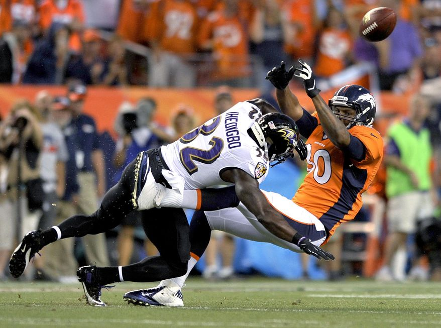 FILE - In this Sept. 5, 2013 file photo, Baltimore Ravens strong safety James Ihedigbo (32) breaks up a pass intended for Denver Broncos tight end Julius Thomas (80) during the first half of an NFL football game, in Denver. A person familiar with negotiations says the Detroit Lions and Ihedigbo have agreed to a two-year contract. The person spoke Tuesday, March 25, 2014, to The Associated Press on condition of anonymity because the deal had not been announced. Ihedigbo made 99 tackles and had three interceptions for the Baltimore Ravens last year.(AP Photo/Jack Dempsey)