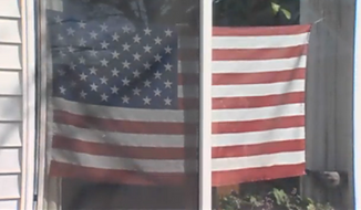 "An Oregon grandmother received a letter threatening her with eviction if she did not remove an American flag from her front window that the letter referred to as ""colored drapes."" (KGW 8)"