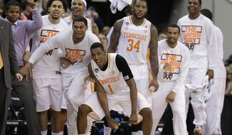Tennessee players celebrate near the end of the second half of an NCAA college basketball third-round tournament game against Mercer, Sunday, March 23, 2014, in Raleigh. Tennessee Won 83-63. (AP Photo/Chuck Burton)