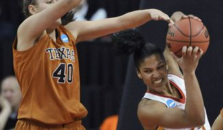 Maryland's Alyssa Thomas, right, fights for a rebound against Texas center Kelsey Lang during the first half of a second-round game of the NCAA women's college basketball tournament, Tuesday, March 25, 2014, in College Park, Md.(AP Photo/Gail Burton)