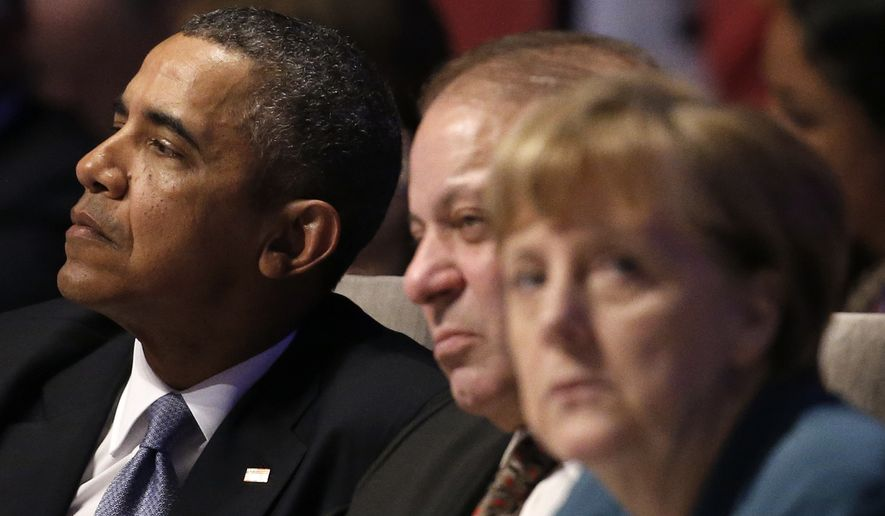 U.S. President Barack Obama, left, Pakistan's Prime Minister Mohammad Nawaz Sharif, center, and German Chancellor Angela Merkel, attend the opening session of the Nuclear Summit in The Hague, the Netherlands, on Monday, March 24, 2014. (AP Photo/Yves Herman, POOL)