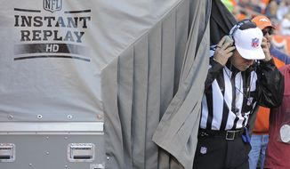FILE - In this Dec. 23, 2012 file photo, referee Al Riverson steps out of the instant replay tent during the second quarter of an NFL football game between the Denver Broncos and the Cleveland Browns, in Denver. League owners passed a rule Tuesday, March 25, 2014, allowing referees to consult with director of officiating Dean Blandino and his staff to help determine whether a call should be upheld or overturned. NFL officials said the change should speed up the process. (AP Photo/Jack Dempsey, File)