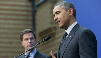 President Barack Obama Obama, accompanied by Dutch Prime Minister Mark Rutte, speaks during their joint news conference at the conclusion of the Nuclear Security Summit in The Hague, Netherlands, Tuesday, March 25, 2014. (AP Photo/Pablo Martinez Monsivais)