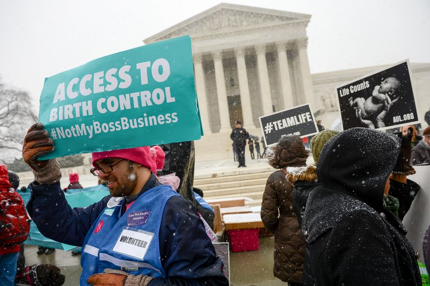 Herschel Pecker of Washington, D.C., left, and others rallying on both sides of the debate over private insurance plans must cover birth control at a rally outside the Supreme Court as the court hears oral arguments in Affordable Care Act challenges, the Sebelius v. Hobby Lobby Stores Inc. and Conestoga Wood Specialties Corp. v. Sebelius, Washington, D.C., Tuesday, March 25, 2014. (Andrew Harnik/The Washington Times)