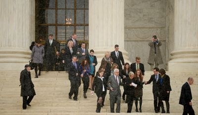 Hobby Lobby Co-founders David and Barbara Green, center right, and others leave the Supreme Court after the court heard oral arguments in Affordable Care Act challenges contraception mandate, the Sebelius v. Hobby Lobby Stores Inc. and Conestoga Wood Specialties Corp. v. Sebelius, which mandate that private insurance plans must cover birth control, Washington, D.C., Tuesday, March 25, 2014. (Andrew Harnik/The Washington Times)