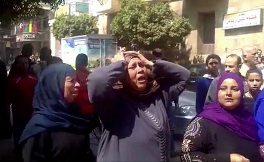 This image made from video shows relatives reacting after an Egyptian court on Monday sentenced to death 529 supporters of ousted Islamist President Mohammed Morsi in connection to an attack on a police station that killed a senior police officer in Minya, Egypt, Monday, March 24, 2014. The convictions came after after two sessions in a mass trial that raised an outcry from rights activists and threatened to spark a violent backlash.(AP Photo via AP video)