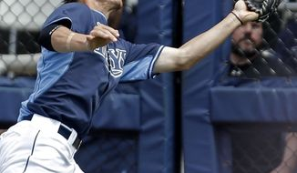 Tampa Bay Rays right fielder Wil Myers grabs a fly out by Boston Red Sox Dustin Pedroia in the fifth inning of an exhibition baseball game in Port Charlotte, Fla., Tuesday, March 25, 2014. The Red Sox won 4-2. (AP Photo/Gerald Herbert)