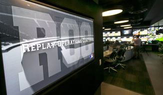 Banks of television screens line the walls of Major League Baseball's Replay Operations Center during a preview of the venue, in New York, Wednesday, March 26, 2014. Less than a week before most teams open, MLB is working on the unveiling of its new instant replay system, which it hopes will vastly reduce incorrect calls by umpires. (AP Photo/Richard Drew)