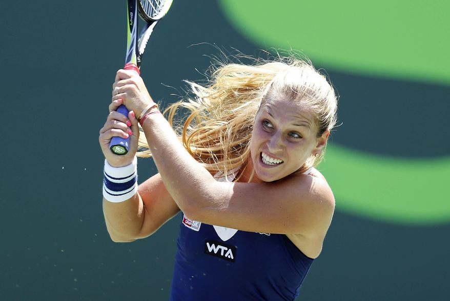 Dominika Cibulkova, of Slovakia, returns to Agnieszka Radwanska, of Poland, at the Sony Open Tennis tournament in Key Biscayne, Fla., Wednesday, March 26, 2014. (AP Photo/Joel Auerbach)