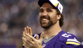 FILE - In this Aug. 29, 2013, file photo, Minnesota Vikings defensive end Jared Allen laughs on the sideline during the second half of an NFL preseason football game against the Tennessee Titans in Minneapolis. The Chicago Bears replaced one accomplished veteran pass rusher with another Wednesday, March 26, 2014, when they agreed to terms with Allen on a four-year contract. A person with knowledge of the agreement told The Associated Press that Allen will get $15.5 million guaranteed on a deal that could be worth as much as $32 million. The person requested anonymity because the terms have not been announced. (AP Photo/Ann Heisenfelt, File)