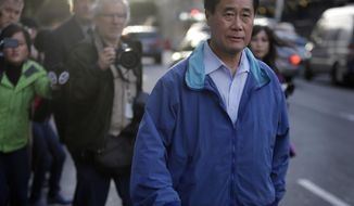California Sen. Leland Yee, D-San Francisco, right, leaves the San Francisco Federal Building, Wednesday, March 26, 2014, in San Francisco.  The FBI has filed a 137-page affidavit outlining a detailed corruption case against Yee, who is accused of asking for campaign donations in exchange for introducing an undercover agent to an arms trafficker. (AP Photo/Ben Margot)