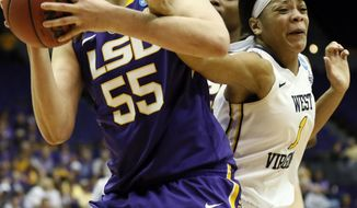 West Virginia guard Christal Caldwell (1) tries to stop LSU forward Theresa Plaisance (55) as she attempts a layup in the first half of an NCAA college basketball second-round tournament game Tuesday, March 25, 2014, in Baton Rouge, La. (AP Photo/Rogelio V. Solis)3