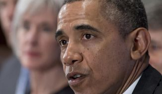 This Jan. 14, 2014, file photo shows President Barack Obama, accompanied by then-Health and Human Service Secretary Kathleen Sebelius, speaking to the media before his Cabinet meeting, in the Cabinet Room of the White House in Washington. (AP Photo/Carolyn Kaster, File)