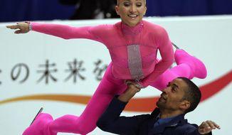 Aliona Savchenko and Robin Szolkowy of Germany perform during the pairs short program of the World Figure Skating Championships in Saitama, near Tokyo Wednesday, March 26, 2014. (AP Photo/Koji Sasahara)