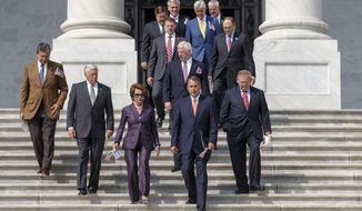 Members of Congress arrive for a ceremony to remember the terror attacks of 9/11, 2001, Wednesday, Sept. 11, 2013, on the steps of the Capitol in Washington. The leading row, from left to right, are Sen. Joe Manchin, D-W.Va., House Minority Whip Steny Hoyer of Md., House Minority Leader Nancy Pelosi of Calif., House Speaker John Boehner of Ohio, and Senate Foreign Relations Chairman Sen. Robert Menendez, D-N.J. (AP Photo/J. Scott Applewhite)