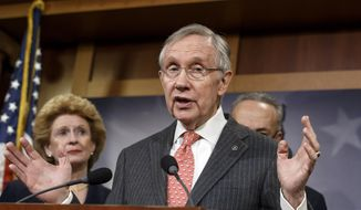 ** FILE ** Senate Majority Leader Harry Reid of Nev., flanked by Sen. Debbie Stabenow, D-Mich., left, and Sen. Charles Schumer, D-N.Y., discuss Democrat legislative agenda during a news conference on Capitol Hill in Washington, Wednesday, March 26, 2014. (AP Photo/J. Scott Applewhite)