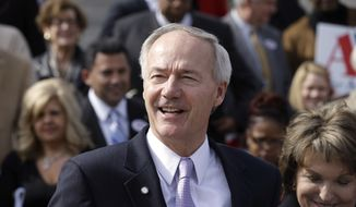 FILE - In this file photo taken Feb. 24, 2014, former U.S. Rep. Asa Hutchinson, R-Ark., speaks at a rally at the Arkansas state Capitol in Little Rock, Ark. Democratic gubernatorial hopeful Mike Ross is criticizing Republican rival Hutchinson for his role prosecuting the impeachment case against former President Bill Clinton. (AP Photo/Danny Johnston, File)