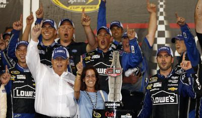 FILE - In this July 6, 2013, file photo, driver Jimmie Johnson, far right, celebrates with his crew and car owner Rick Hendrick, left, after winning the NASCAR Sprint Cup auto race at Daytona International Speedway in Daytona Beach, Fla. Hendrick watched victory slip away for two of his drivers at Auto Club Speedway. Johnson was leading in the closing laps until a tire failure sent him to pit road and cost him his first win of the season. His misfortune appeared to be Hendrick Motorsports teammate Jeff Gordon's gain, though, as Gordon inherited the lead from Johnson. (AP Photo/Reinhold Matay, File)