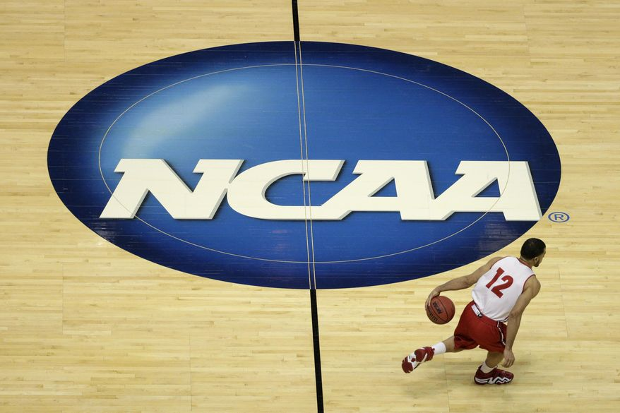 Wisconsin's Traevon Jackson dribbles past the NCAA logo during practice at the NCAA men's college basketball tournament Wednesday, March 26, 2014, in Anaheim, Calif. Wisconsin plays  Baylor in a regional semifinal on Thursday. (AP Photo/Jae C. Hong)