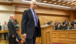 Safety Commissioner Bill Gibbons leaves the podium during a House Criminal Justice Committee hearing in Nashville, Tenn., on Wednesday, March 26, 2014. The panel later advanced Gov. Bill Haslam's bill seeking to cap the amount cold and allergy medicines used to make meth can be bought each year without a prescription, though with far looser restrictions than in the Senate version. (AP Photo/Erik Schelzig)