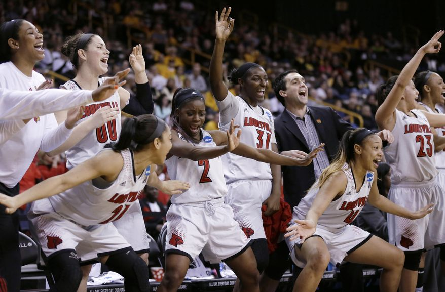 Louisville players celebrate at the end of an NCAA women's college basketball tournament second-round game against Iowa, Tuesday, March 25, 2014, in Iowa City, Iowa. Louisville won 83-53. (AP Photo/Charlie Neibergall)