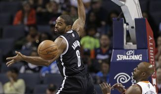 Brooklyn Nets' Alan Anderson (6) reaches for a loose ball as Charlotte Bobcats' Anthony Tolliver (43) defends during the first half of an NBA basketball game in Charlotte, N.C., Wednesday, March 26, 2014. (AP Photo/Chuck Burton)