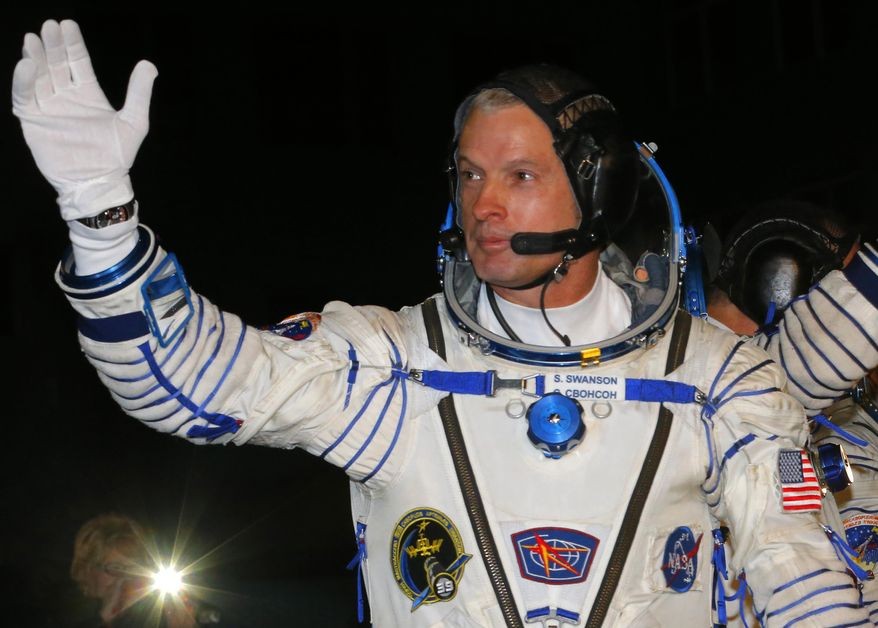 U.S. astronaut Steven Swanson, a crew member of the mission to the International Space Station (ISS) gestures prior the launch of Soyuz-FG  rocket at the Russian leased Baikonur cosmodrome, Kazakhstan, Wednesday, March 26, 2014. (AP Photo/Dmitry Lovetsky, Pool)